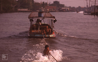 Boy changes boats, Bangkok, 1989