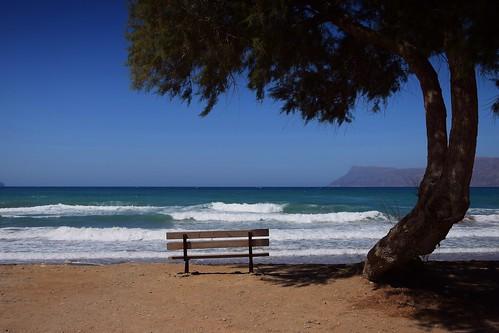 summer mood blue sea water waves nature tree bench landscape view seascape light shadow beach sunny hot holiday kissamos crete kriti kreta greece greek