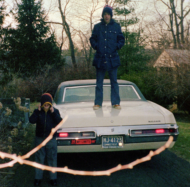 Conclusive proof that teenagers used to stand on the trunks of their parent's cars in the 1970s. Note the gas-crisis era sticker of