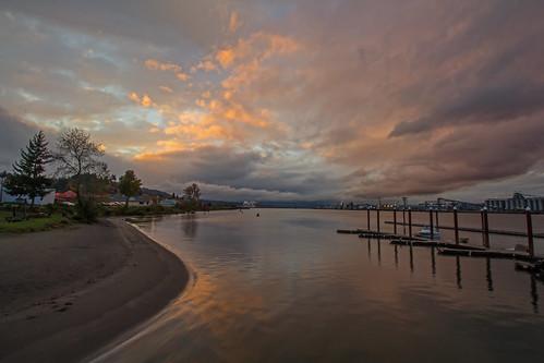 sunset columbiariver rainieroregon clouds water docks color beach oregon