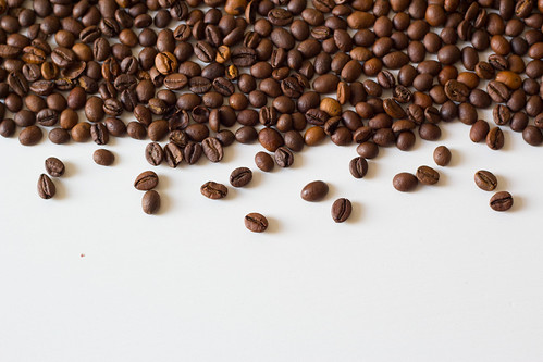 Coffee beans on white table | by wuestenigel