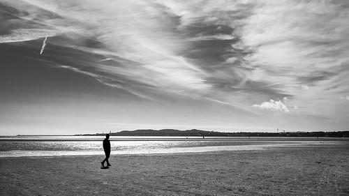 streetphotography ireland street city faceless clouds sea man contrast blackandwhite candid bw photo photography dublin urban sky europe geotagged white countydublin ie onsale