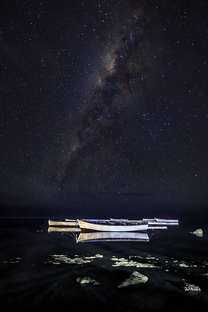 The milky way above the boats