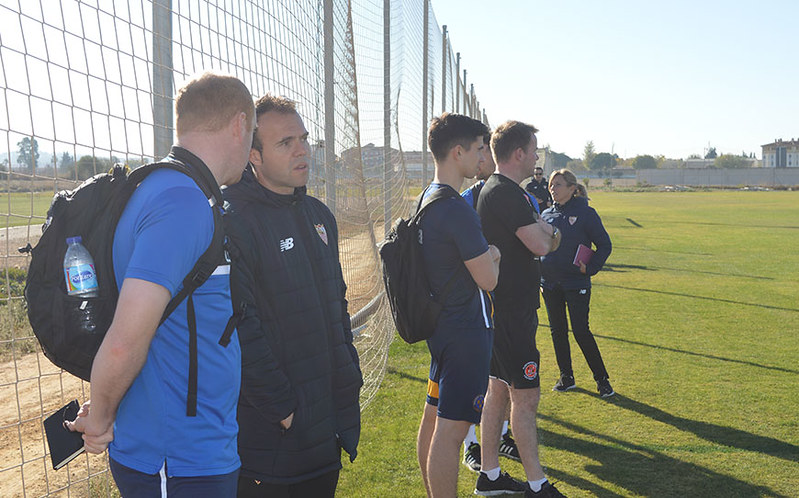 The coaches watch on from the sidelines after arriving at Sevilla