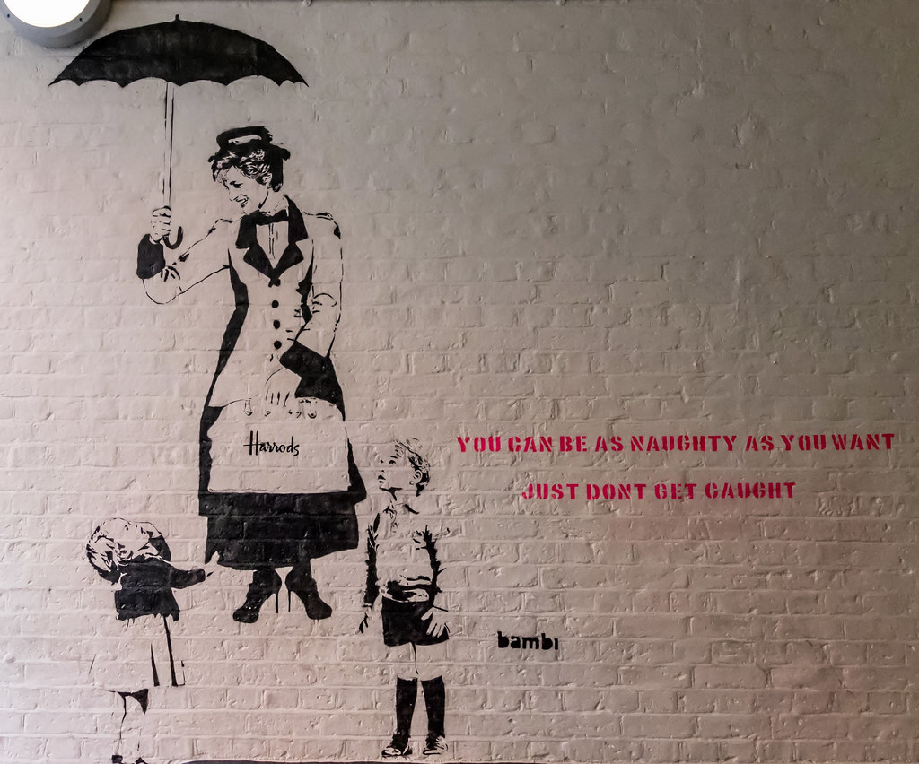 On 31st of August 2017, on the 20th anniversary of Princess Diana's death, Bambi unveiled 'Be As Naughty As You Want'. The piece presents Princess Diana as Disney's Mary Poppins, being carried into the sky by her magical flying umbrella, watched by Prince George and Princess Charlotte. The work is located at the entrance to Neal's Yard, off Monmouth Street in Covent Garden, London. Thanks : Wiki
