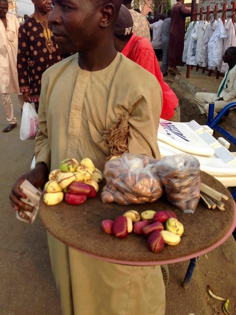 Hausa man selling bitter kola, kola nut and chewing stick
