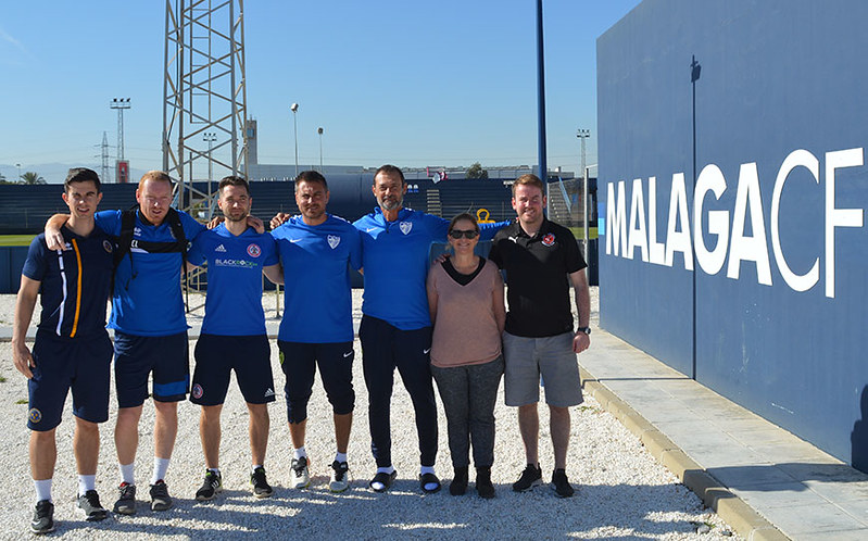 The group get a photo with Maria Valenzuela & the Malaga staff