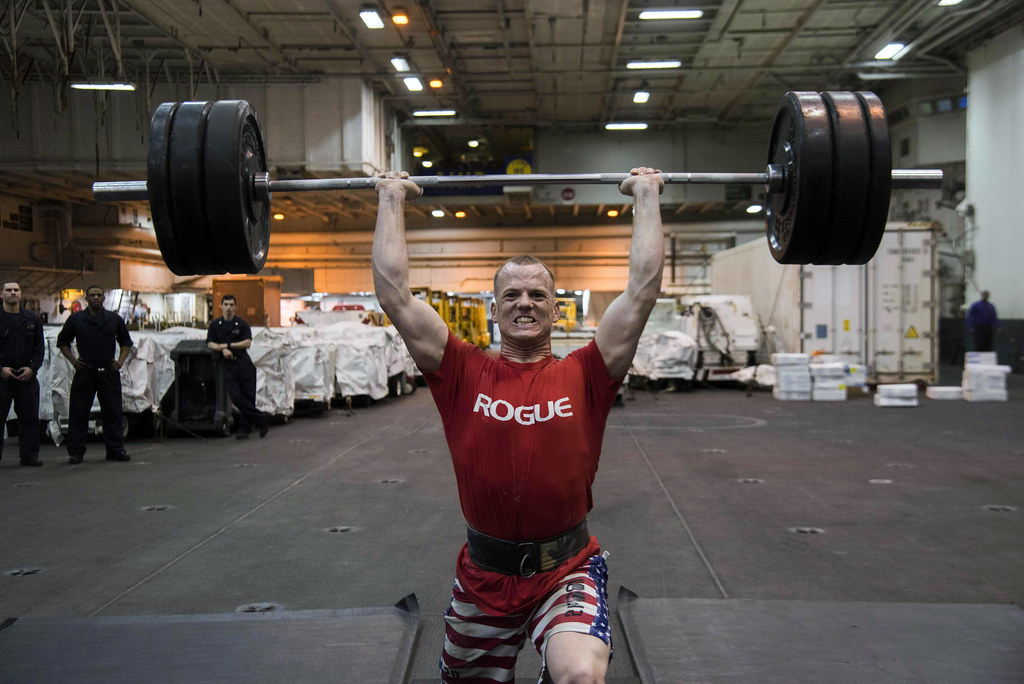 Sailor lifts weights during the Ike Strength Fest competition.