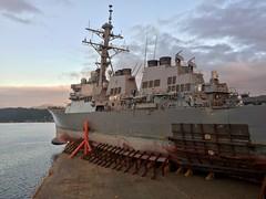USS John S. McCain (DDG 56) departs Subic Bay aboard heavy lift transport vessel MV Treasure, Nov. 28. (U.S. Navy/Lt. Aaron Van Driessche)