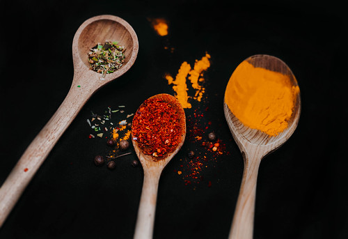 Wooden Spoons With Colorful Spices   by wuestenigel