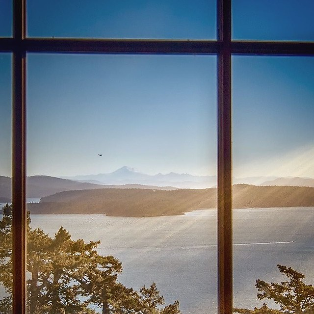 A sunny afternoon on the staircase overlooking the Salish Sea. Float Planes at eye level, as if you could just reach out and grab them. Wake of boats like chalk marks on the Sea's surface. All in the omnipresence of Mount Baker & the San Juan Islands - Ea