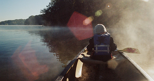 morning film canon canonef canonfd28mmf28 kodakportra400 canoes pleasanthilllake ohio rural camping sunflare lake water outside outdoors calm paddling paddle family foggy dawn sunrise thefindlab