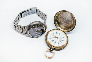 Old Pocket Watch And Titan watch isolated on the white background   by wuestenigel