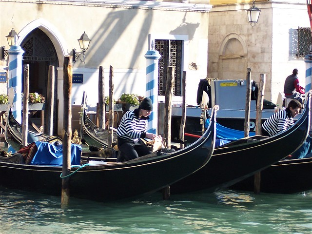 Grand Canal - gondoliers maintaining their boats