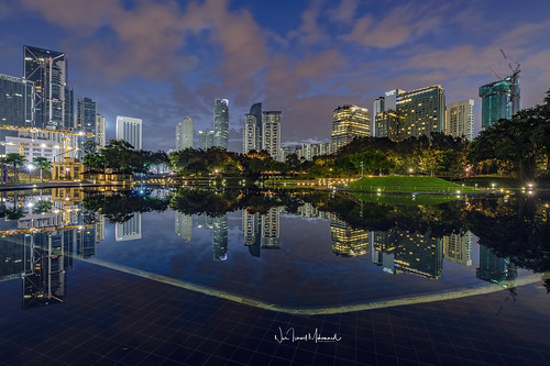 hdr nightphotography nighthdr nurismailmohammed nurismail nurismailphotography frozenlite reflection lake lights construction klccpark kualalumpur architecture buildings water trees