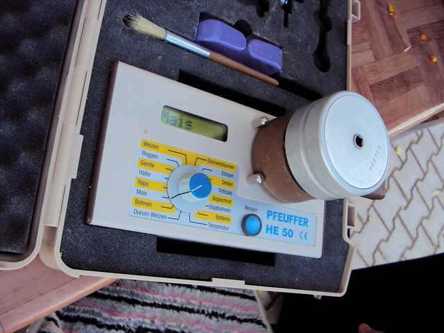 Step three: put the ground kernels on this magic German machine, and it will tell you the water content. by bryandkeith on flickr