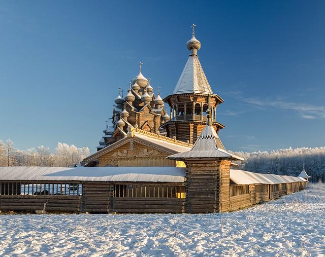 Russia, Saint Petersburg suburbs. A winter view of the belfry and Pokrovskaya church at Bogoslovka manor.