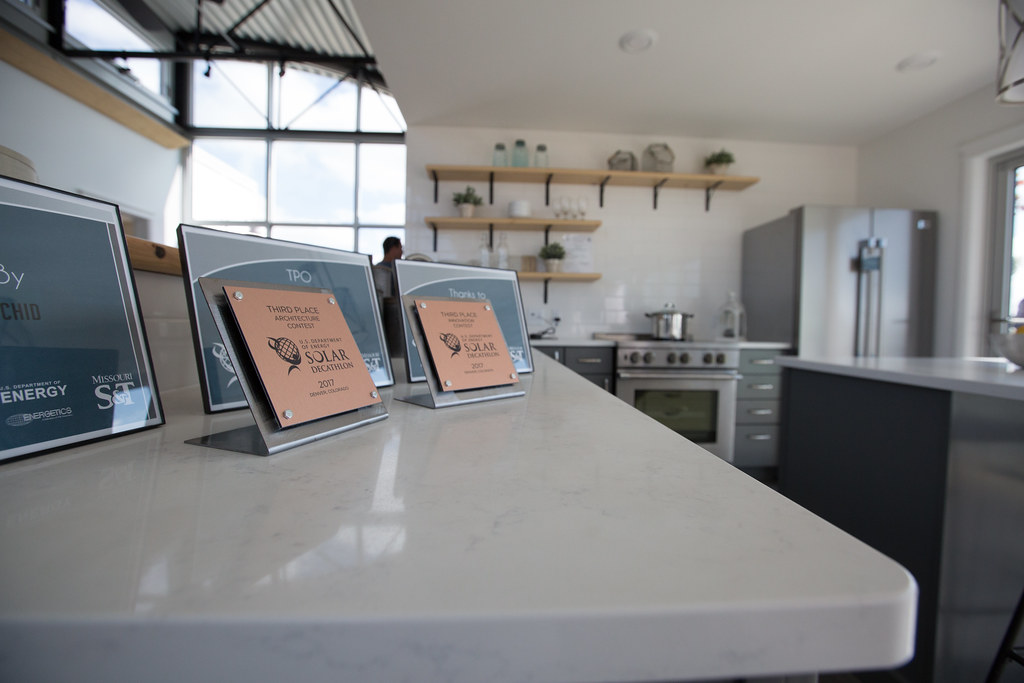 6cd07cb11 The U.S. Department of Energy Solar Decathlon 2017 team from Missouri  University of Science and Technology displays their competition award  hardware in the ...