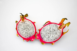 Sliced Dragon Fruit on a White Background | by wuestenigel