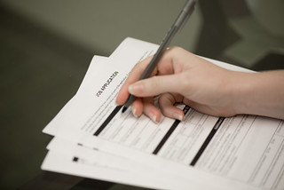Woman Filling Out Job Application | by amtec_photos