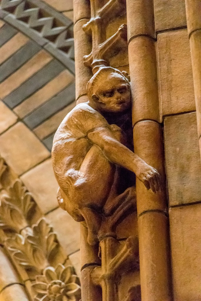 One of seventy eight monkey statues climbing the columns in the Central Hall.