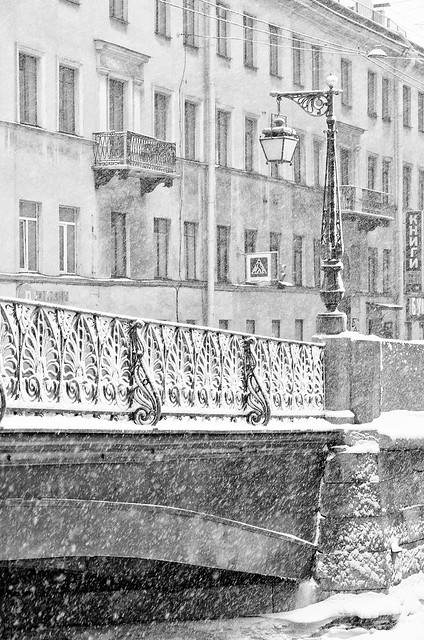 The strong snowstorm in Saint Petersburg. Demidov bridge.  B/w image.