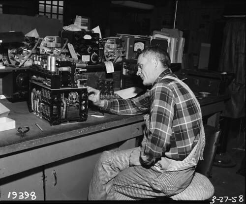 Engineering Dept. employee repairing traffic signal, 1958 | by Seattle Municipal Archives