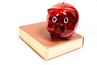 Red Piggy Coin Bank on Old Book | by ShebleyCL
