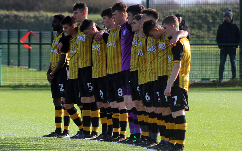 The Owls youngsters stand together for a minute's silence