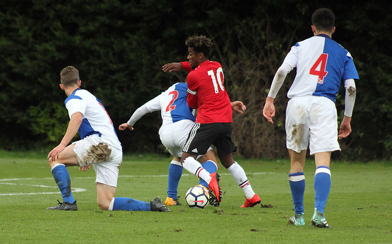 Angel Gomes weaves his way through the Rovers defence