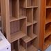 Rio walnut staggered shelf bookcase E150