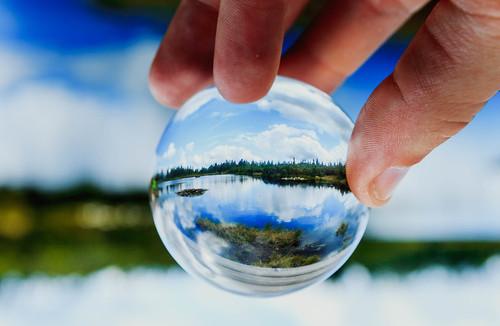 Lake reflected in glassball | by wuestenigel