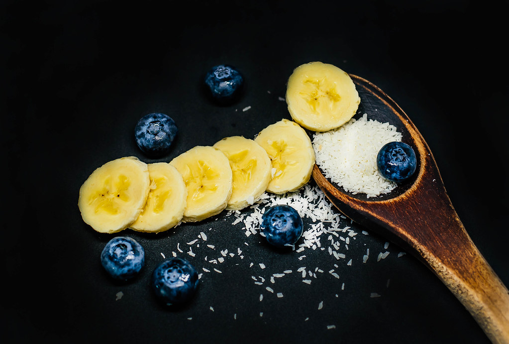 Wooden Spoon with Coconut, Banana Slices and Blueberries | Flickr