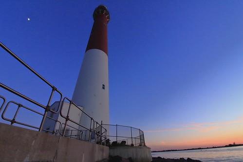 jerseyshore jersey summertime summer 1018mm nj barnegat lighthouse towering goldenhour newjersey sunset moon landscape wideangle canon canoncameras t6