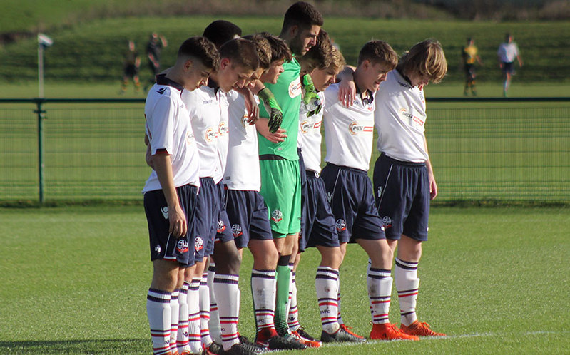 Young Trotters pay their respects during a minute's silence