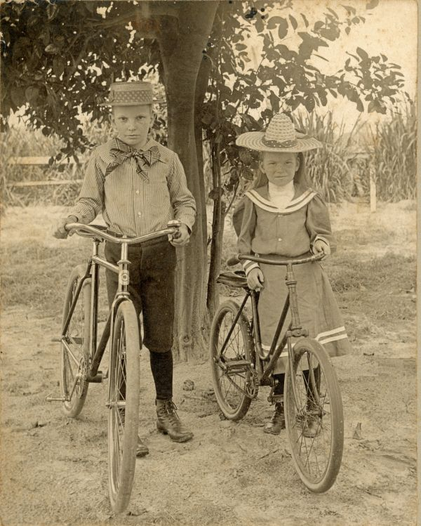 Herbert E. Fuller and sister Irene with their bicycles at Spring Lake Farm