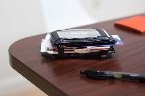 Overstuffed Wallet on Desk | by yourbestdigs