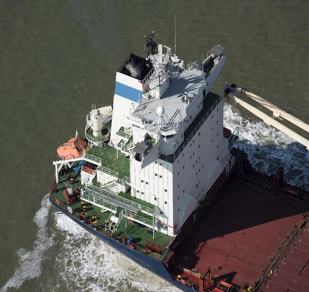 Vitim container ship docking at Felixstowe - Suffolk uk aerial