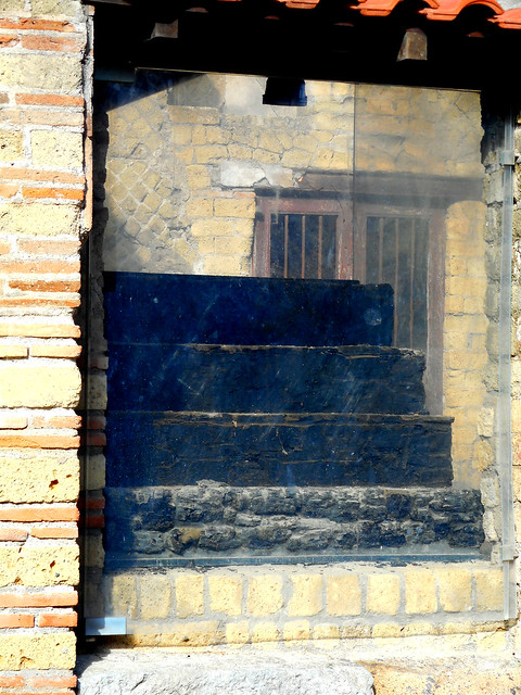 Flight of stairs of carbonized wooden at Herculaneum, buried by Vesuvius' eruption on 79 AD