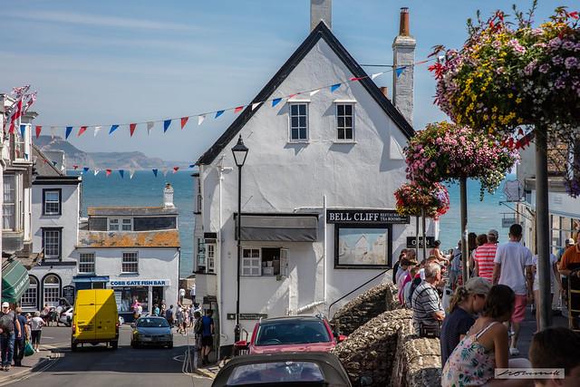 Lyme Regis High Street looking towards the Golden Cap near Charmouth. Dorset.