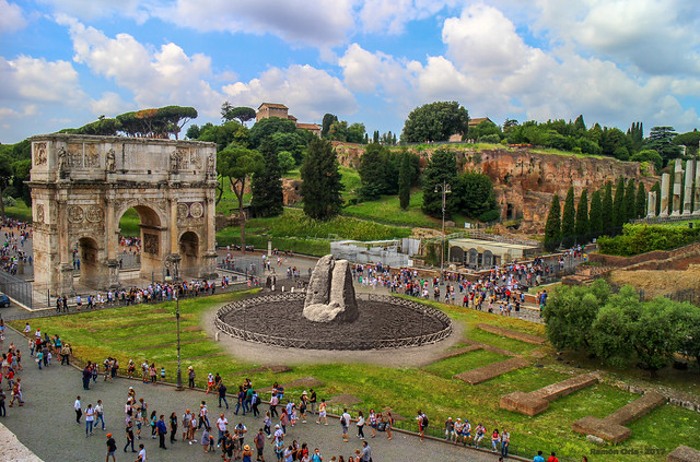 Arch of Constantine in 2016, and the remains of Meta Sudans in about 1920-30. Rome