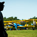 PT-17 Stearman biplanes and other aircraft are parked on the flightline before the show begins at the Flying Circus Aerodrome and Airshow in Bealeton, Va., Jul. 30, 2017. (U.S. Air Force photo by J.M. Eddins Jr.)