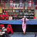 China October 2017. Guilin. The waitress in pink dress. by Jean-Paul Margnac