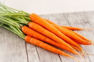 Carrots Close-up on a Wooden Background | by wuestenigel