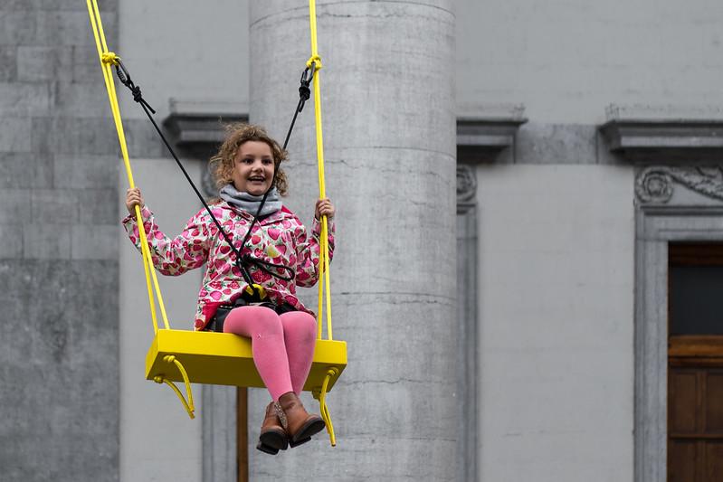 Girl on yellow swing