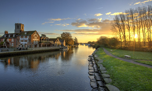 wareham dorset uk frome riverfrome river dawn landscape bluesky golden reflection water trees boats yachts