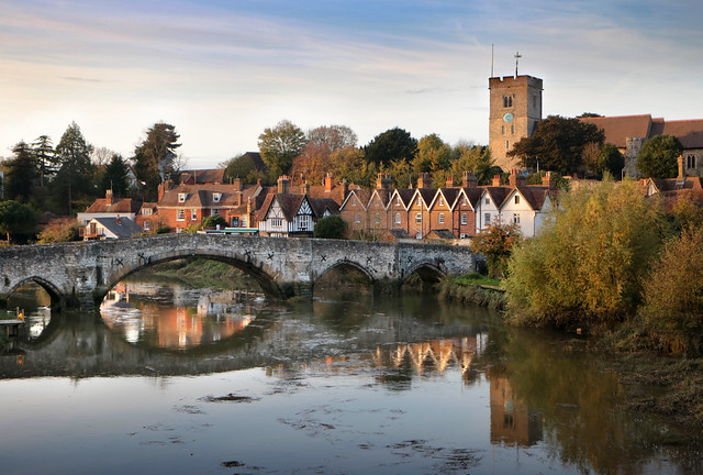 Aylesford bridge and town from new bridge (closer) on the river Medway in golden late afternoon sun