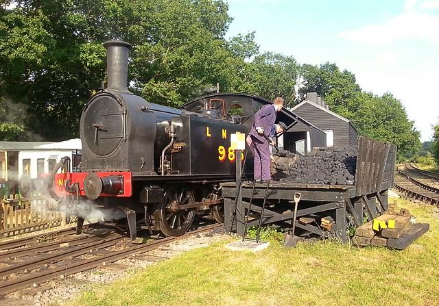Just three short months ago, but so much warmer, T W Wordsells Y7 0-4-0 Tank Locomotive, No.985 being coaled up between trains. Mid Suffolk Railway. 27 08 2017