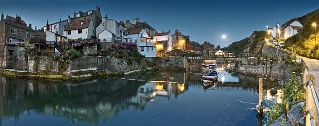 Staithes in the moonlight, the street lights and the first light of dawn.