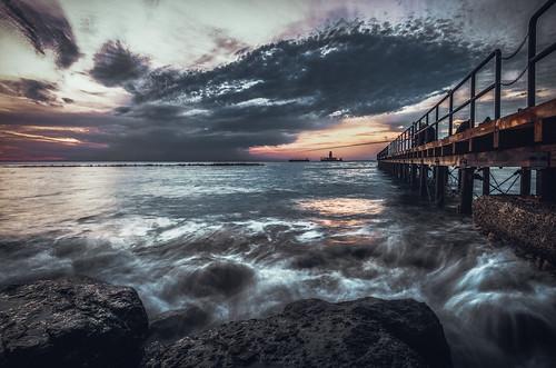 longexposure sunrise clouds dock pier seascape waves water sea jetty rocks dramatic landscape cyprus sony sonya6000 ilce6000 samyang samyang12mmf20ncscs haidand30 manfrottobefree
